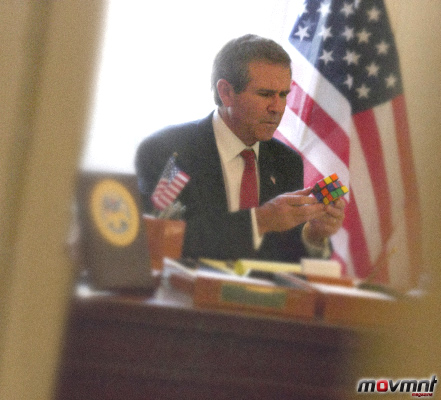 George W Bush tries to solve a Rummy Cube in the Oval Office - Photo by Alison Jackson